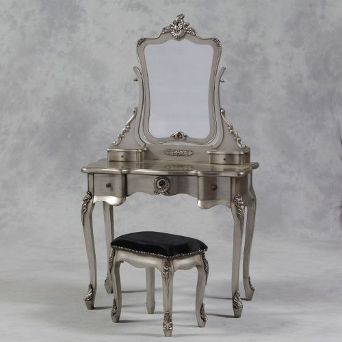 A Dressing Table Set in Antique Silver